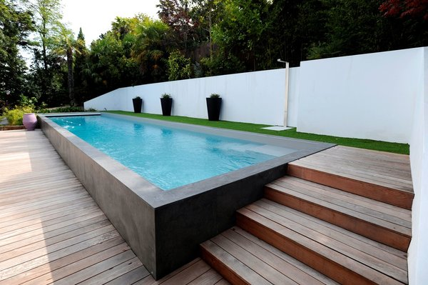 construire une piscine couloir de nage jardin piscine et cabane. Black Bedroom Furniture Sets. Home Design Ideas